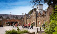 Image of students walking across the Stable Block courtyard at Swansea University