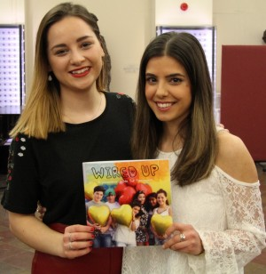 Katie Miller (left) and Hannah Phillips with the Wired Up booklet.